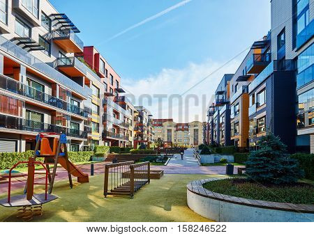 Modern Residential Buildings And Children Playground