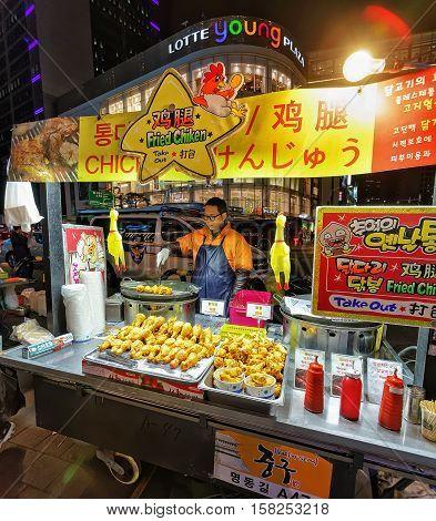 Seller Of Fried Chicken At Myeongdong Open Street Market Seoul