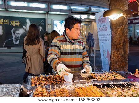Seller Of Kebab Skewers In Myeongdong Street Market Seoul