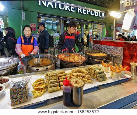 Sellers Of Seafood At Myeongdong Open Street Market In Seoul