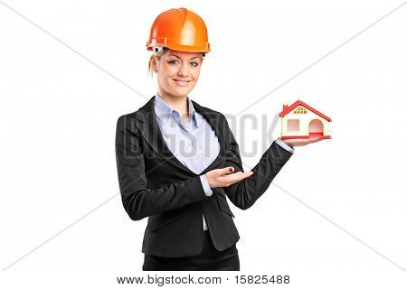 A forewoman holding a model house isolated on white background