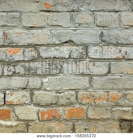 Grungy Brickwall With Broken Stucco Frame Texture. Old Brick Wall With Damaged Shabby Color Plaster Square Background. Distressed Stonewall Rectangular Surface. Chipped Rough Uneven Fence