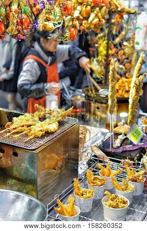 Woman Selling Seafood At Myeongdong Open Street Market Of Seoul
