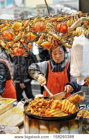 Woman Selling Seafood In Myeongdong Street Market In Seoul
