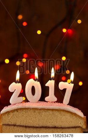 2017 Candles Burning On Top Of A Cake