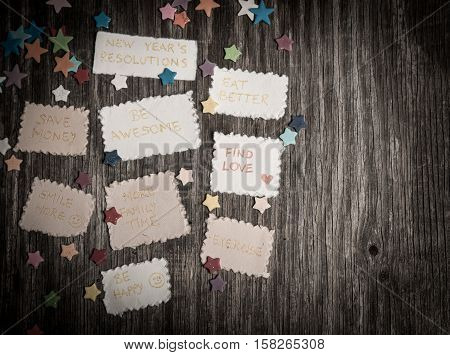 New Year Goals Or Resolutions With Decorations On Rustic Wooden Background