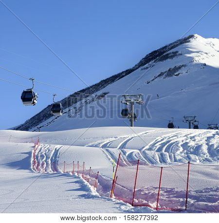 Gondola Lift On Ski Resort At Sun Winter Day