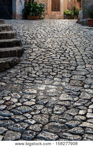 Old stone granite street in Majorca, Spain