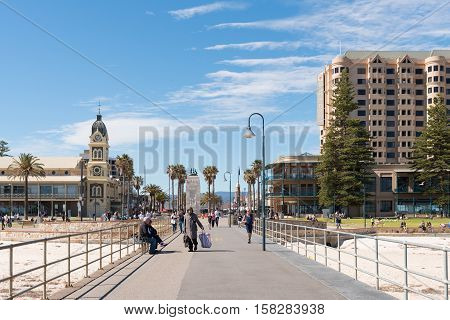 Adelaide Australia - August 28 2016: Tourists and locals at the beautiful Adelaide beachside suburb of Glenelg