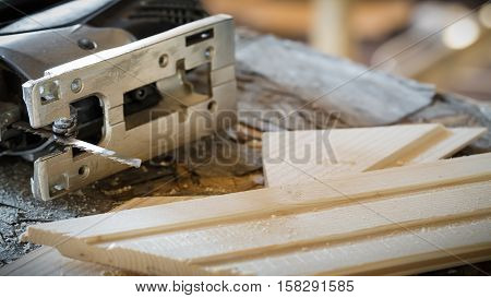Fretsaw And Tongue And Groove Boards On Working Place