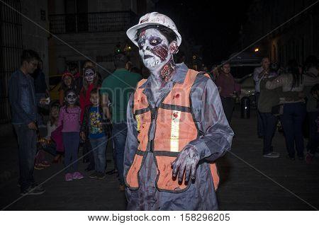 OAXACA, OAXACA, MEXICO - NOVEMBER 1, 2016: Worker zombie at traditional day of the dead parade in Oaxaca, Oaxaca, Mexico