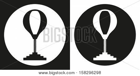 Punching bag icon. Silhouette punching bag on a black and white background. Sports Equipment. Vector Illustration