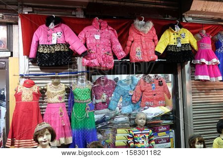 KOLKATA, INDIA - FEBRUARY 10: Mannequins dressed in latest Indian Children's clothing in front of a retail cloth shop in Kolkata, India on February 10, 2016.
