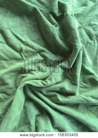 close up green crease fabric textile texture