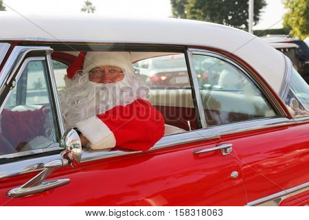 poster of Santa Claus drives his Hot Rod Car. Santa Drives his car. Santa Claus arrives in style. Santa Cruise