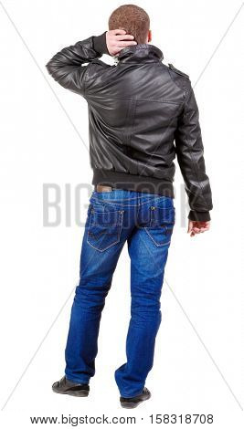 Back view of thinking  man. gesticulating adult man in black jacket and jeans . Rear view people collection.  backside view of person.  Isolated over white background.