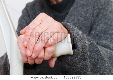 Close up picture of a handicap elderly woman's hand