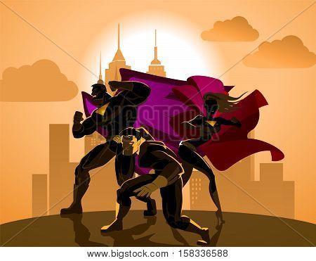 Superhero Team; Team of superheroes posing in front of a light.