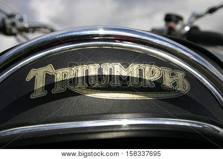 Triumph Bonneville 750cc Motorcycle. Photographed at Coleford Carnival of Transport, England. 11th April 2009. (rear seat emblem)
