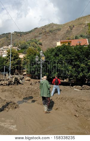GiampilieriItaly - October 3 2009. A landslide has invaded the Sicilian town causing many deaths. The collapse of a mountain caused hundreds of tons of earth and rock fell on buildings and cars.