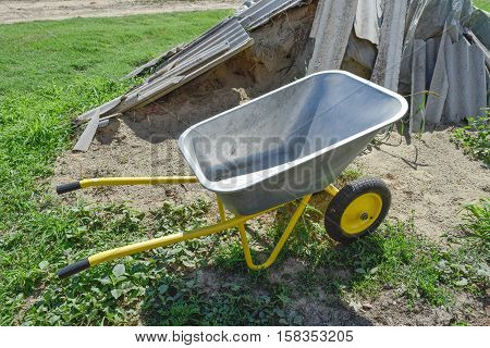 Gardening Wheelbarrow For Transportation Of Sand And Earth. Two-wheel Yellow Car