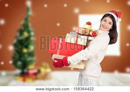 Christmas, X-mas, New Year, Winter, Happiness Concept - Smiling Woman In Santa Helper Hat With Gift