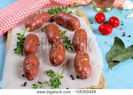 Fresh chorizo sausages with bay leaves pepper and tomatoes