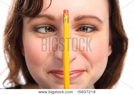Fun Moment As Girl Holds Pencil Between Her Eyes