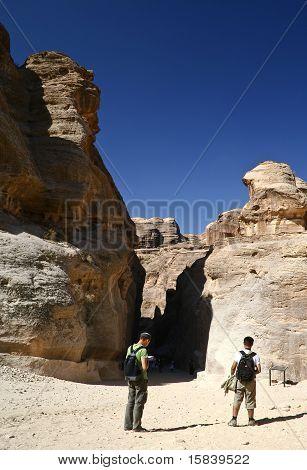Tourists Walking In Gorge Petra In Jordan