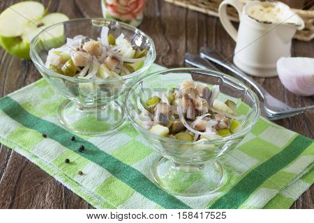Festive Salad With Pickled Herring, Vegetables And Apple. Appetizer On The Table Christmas Or New Ye