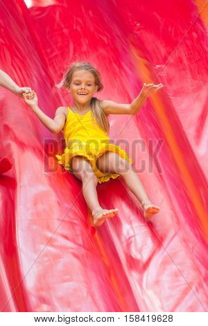 Child Drives Off The High Inflatable Trampoline