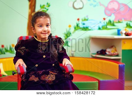 Cute Little Girl In Wheelchair At Rehabilitation Center For Kids With Special Needs