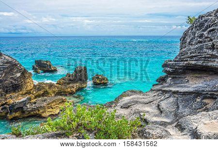 Beautiful rock formations and aqua marine water of Horseshoe Bay in Bermuda.