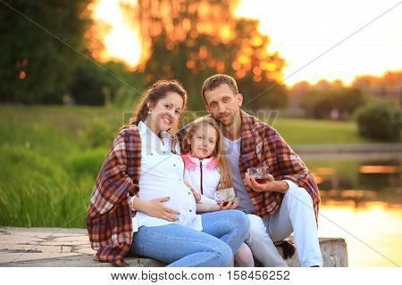happy family mother father and daughter are waiting for replenishment in the family