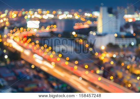 Blurred lights night view city highway curved, abstract background