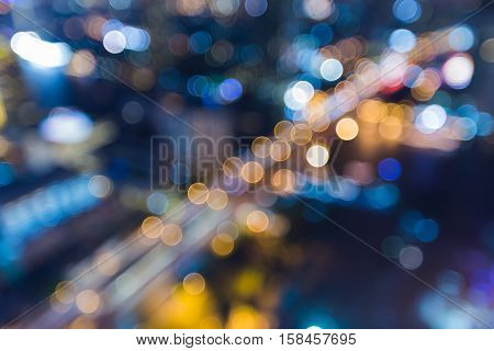Night blurred lights aerial view city road, abstract background