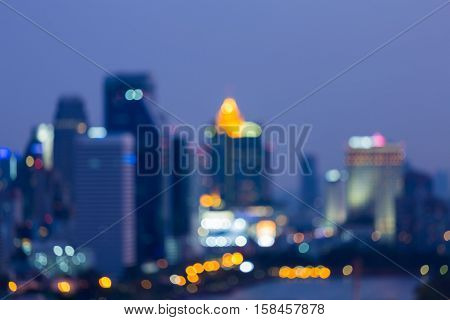 Blurred lights city night abstract background at twilight
