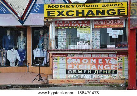 PATTAYA THAILAND - 22 NOV 2016: Money exchange shop on the corner of a street in Pattaya Thailand.