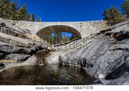 Stone Bridge Over A River In The Mountains