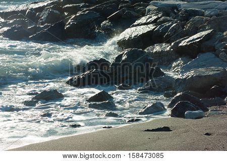 waves crashing on the sea beach rocks