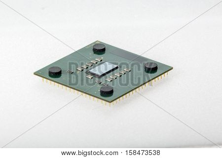 CPU. Modern computer processor unit. The microprocessor is located on a green PCB. 4 mounting pads on the card and microelements around the processor chip. Isolated on white background.