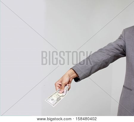 Businessman Hand Holding Us Dollar, Usd. Bills, Offers Dollar Bank Note Money.