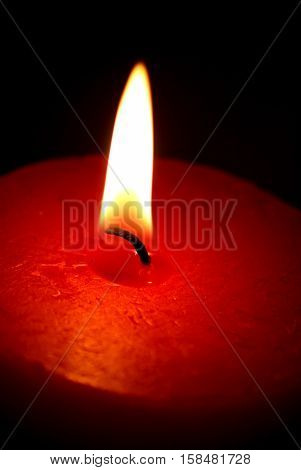 Red Candle on black background vertical image