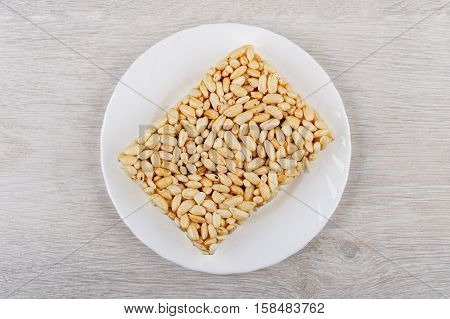 Brick Of Puffed Rice In Glass Plate On Wooden Table