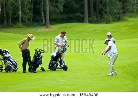 Group golfer, golfer finishes his swing