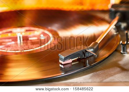 Vintage turntable with a record in playing