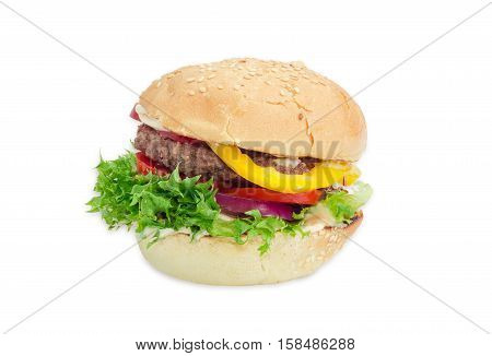 Traditional hamburger with beef patty vegetables and condiments on a light background