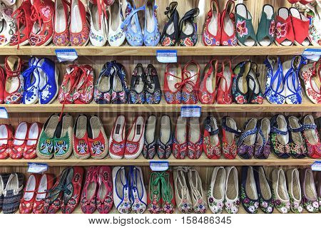 Lijiang, China - November 10, 2016: Close Up Of Hand Made Shoes, One Of The Artigianal Products Of L
