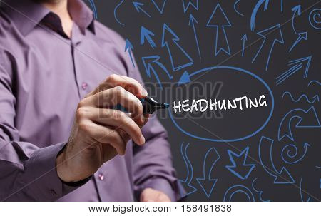 Technology, Internet, Business And Marketing. Young Business Man Writing Word: Headhunting