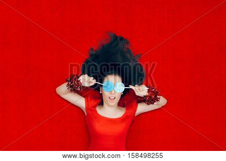 Surprised Christmas Girl Holding Lollipops on Red Background
